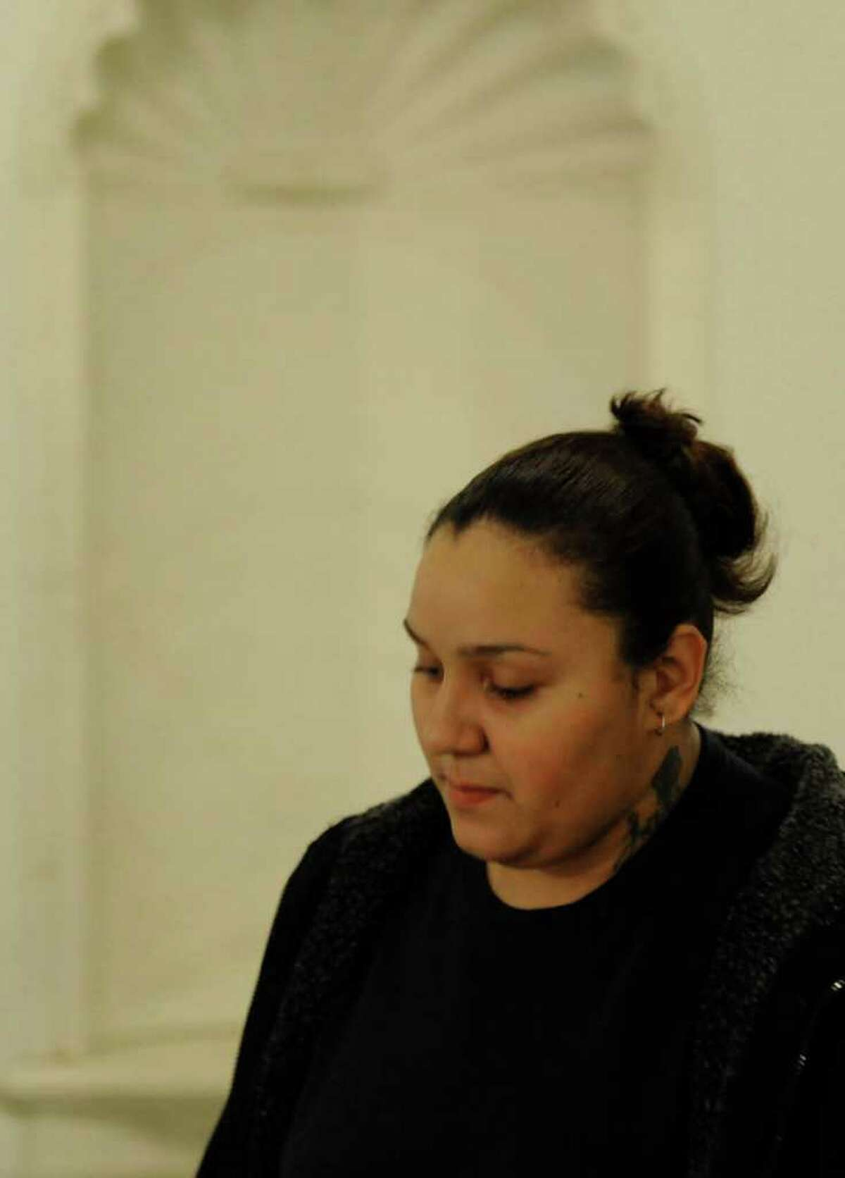Jasmine L. Tirado leaves Schenectady City Court, after her appearance Dec. 7, 2011. (Skip Dickstein / Times Union)