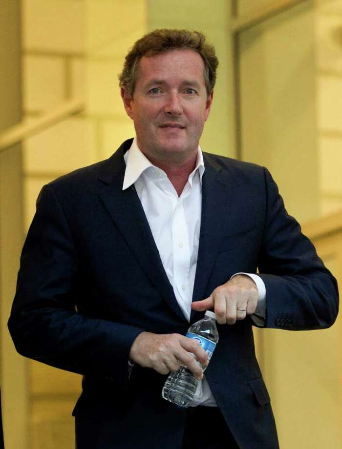"Piers Morgan, host of CNN's ""Piers Morgan Tonight,"" leaves the CNN building in Los Angeles, Tuesday, Dec. 20, 2011. A tense and sometimes hostile Piers Morgan refuses to disclose details about the most damning link between himself and Britain's phone hacking scandal — his acknowledgment that he listened to a phone message left by Paul McCartney for his then-wife Heather Mills. (AP Photo/Jae C. Hong) Photo: Jae C. Hong"