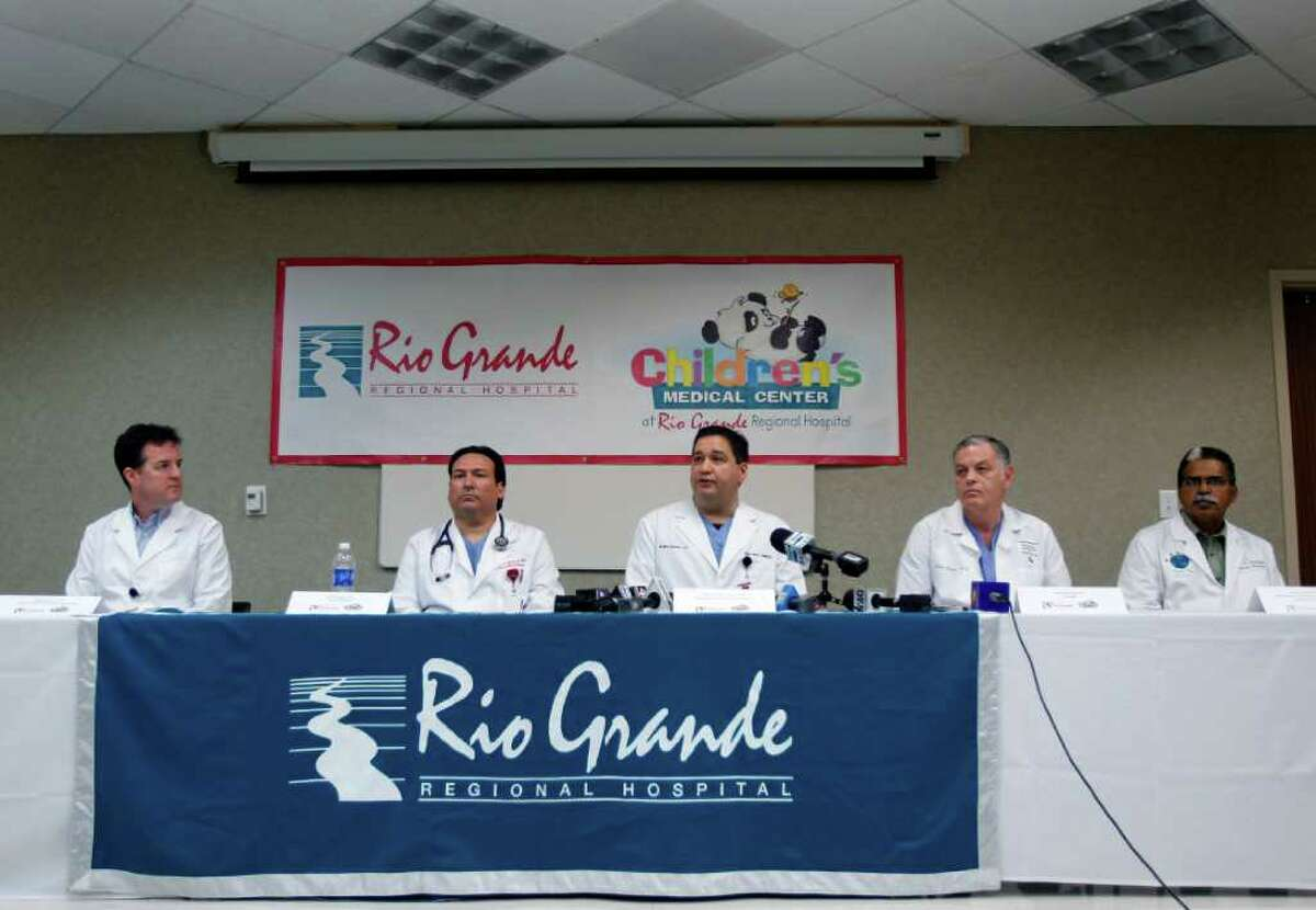 Dr. Carlos Garcia-Cantu, center, talks about the condition of one of the two teen boys that was shot, during a news conference Wednesday Dec. 21, 2011 at Rio Grande Regional Hospital in McAllen, Texas. After the boys were shot Dec. 12, investigators questioned three men who were found on adjacent ranchland. Two were practicing target shooting and were in line with the students. A third was an illegal immigrant with an assault rifle who was trespassing. (AP Photo/The Monitor, Nathan Lambrecht)