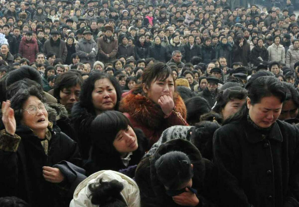 North Koreans grieve as they visit a portrait of late leader Kim Jong Il at Kim Il Sung Square in Pyongyang.