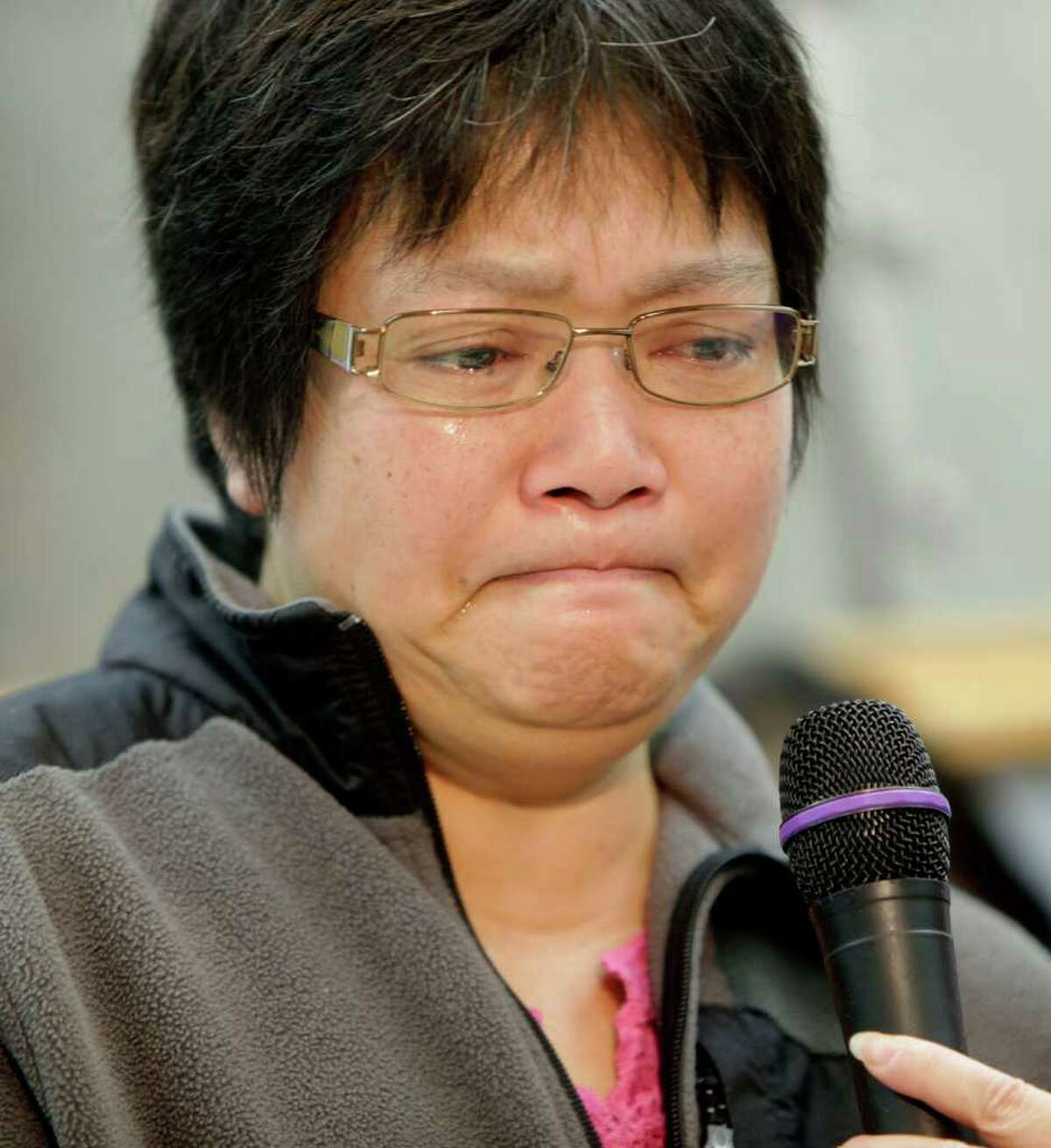 Su Zhen Chen, mother of Pvt. Danny Chen, weeps while speaking during a news conference in New York. Pvt. Chen was found on Oct. 3 in a guard tower in the Kandahar province of Afghanistan with what the Army has described as