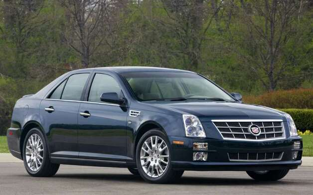 The Cadillac STS is one of the vehicles being discontinued. Photo: Courtesy Of General Motors Co., Wieck / Cadillac