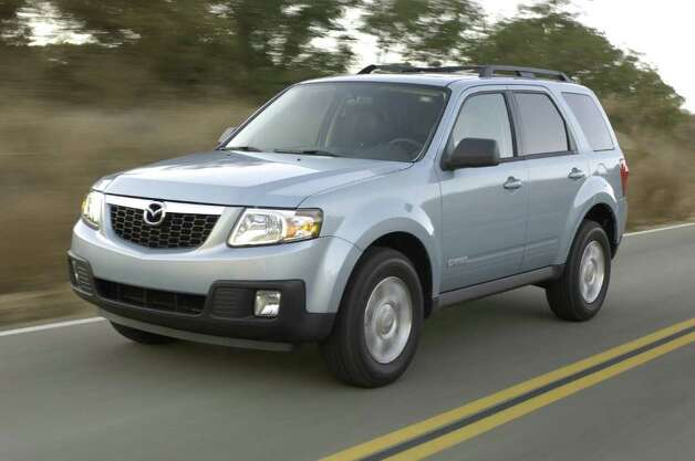 The Mazda Tribute is one of the vehicles being discontinued. Photo: Courtesy Of Ford Motor Co., Wieck / © 2007 Ford Motor Company