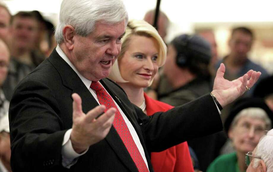 Newt Gingrich and his wife, Callista, were in Iowa this week trying to bolster his falling numbers there.                     Photo: Associated Press, Charlile Riedel