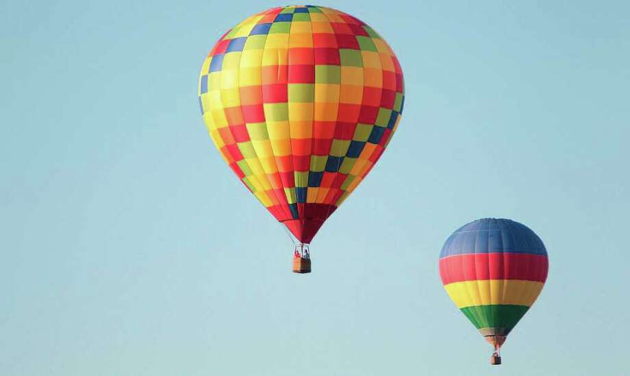 Kyle, Texas will host their inaugural Pie in the Sky hot air balloon festival on Labor Day weekend. The event will feature over 25 hot air balloons illuminating the evening sky. Photo: Mayra Beltran, Staff / © 2011 Houston Chronicle