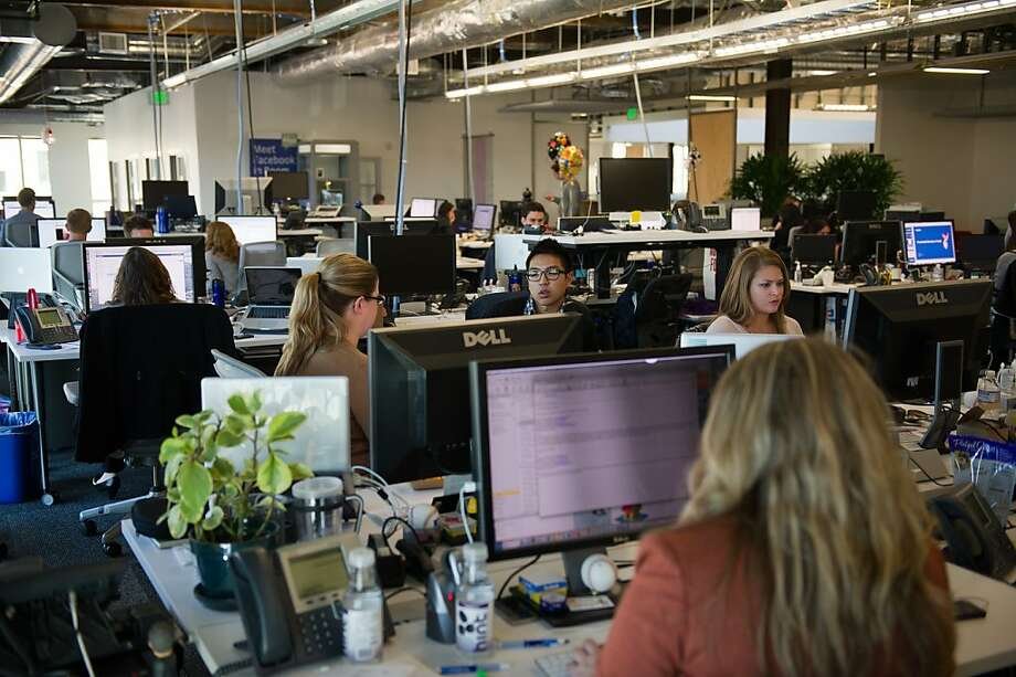 Facebook Inc. employees work at the company's new campus in Menlo Park, California, U.S., on Friday, Dec. 2, 2011. Facebook hopes to accommodate over 6,000 employees on the new campus, which will spread out over a million square feet of office space when completed in mid-December 2011. Photographer: David Paul Morris/Bloomberg Photo: David Paul Morris, Bloomberg