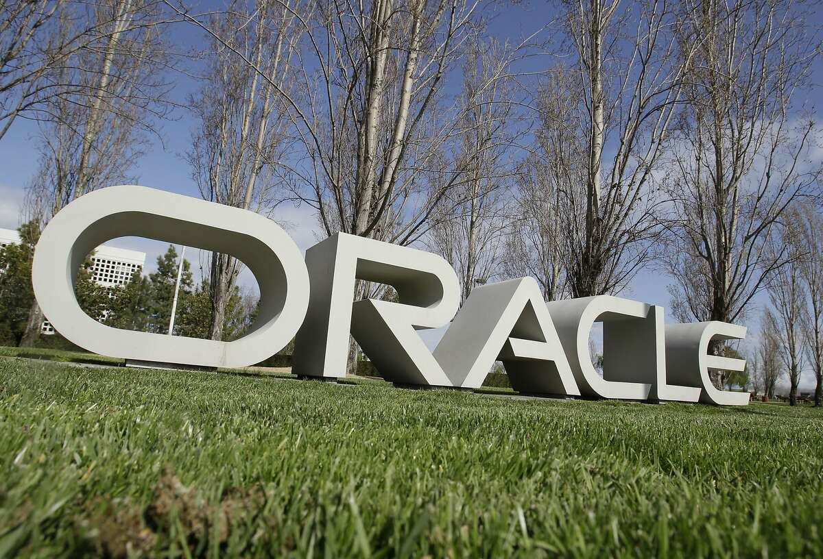 The company logo for Oracle Corp. headquarters is shown in Redwood City, Calif.