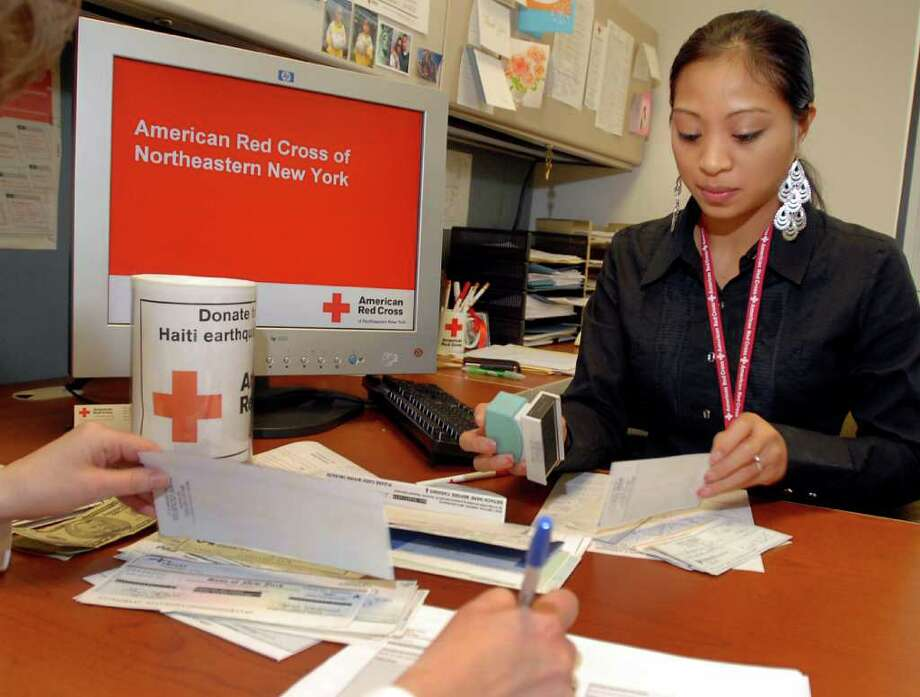 Volunteer administrator Sheelah Aplasca helps sort through the donations on Thursday, Jan. 14, 2010, at the Red Cross of Northeastern NY in Colonie, N.Y. (Cindy Schultz / Times Union) Photo: CINDY SCHULTZ / 00007198A