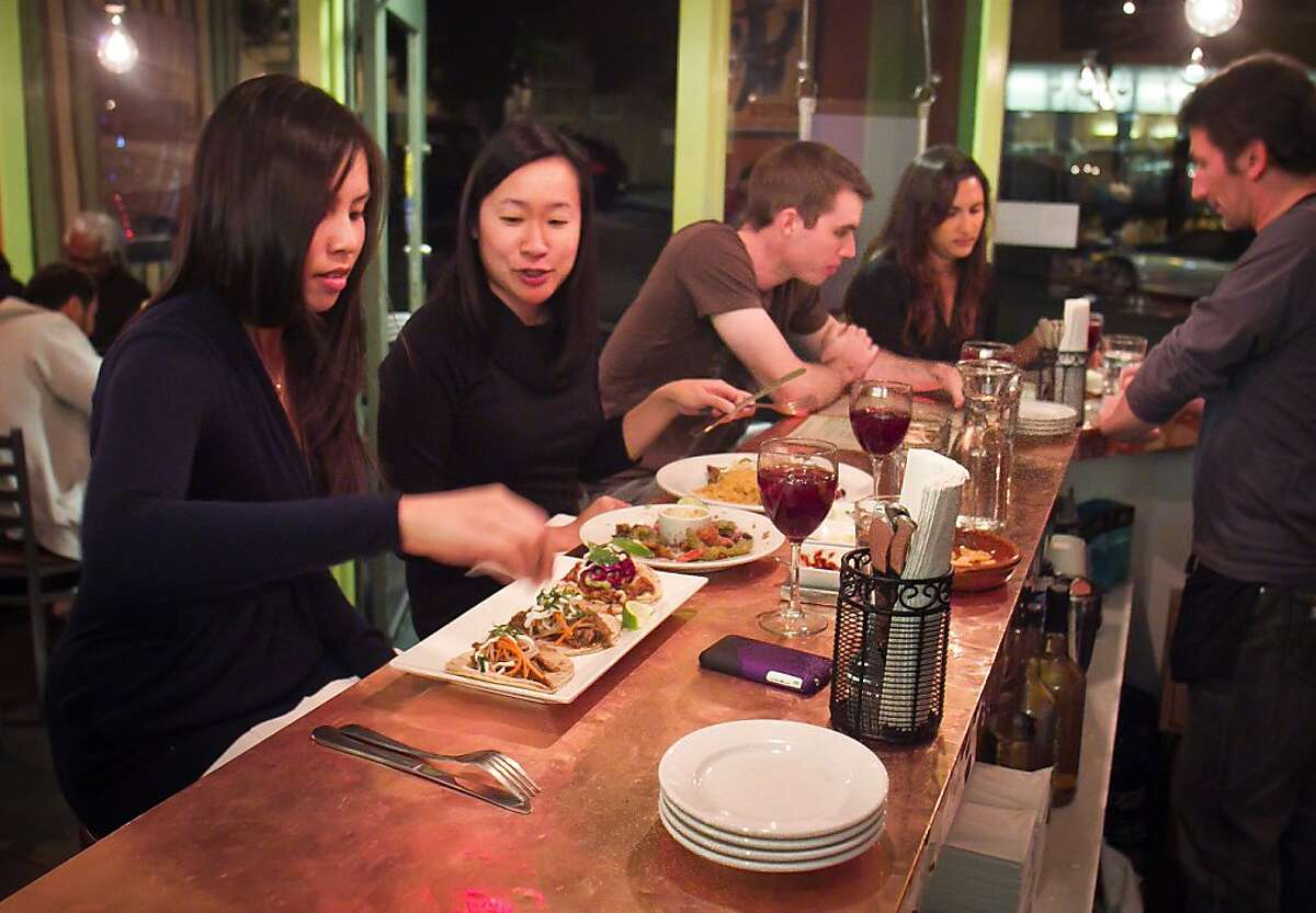 Diners enjoy appetizers at Papito Restaurant in San Francisco, Calif., on Friday, December 2nd, 2011.