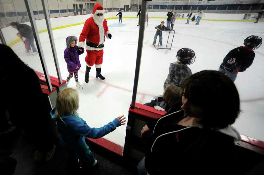 "Patrick Schamburek of Manitowoc, portraying Santa Claus, mingles with children during a ""Santa Skate"" event at the Manitowoc, Wis. County Expo Center  in Manitowoc, Wis. Photo: Matthew Apgar, Associated Press / Herald Times Reporter"