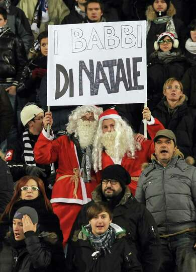 Udinese's Santa Clauses cheer team's player Alessandro Di Natale (literally translated 'from Christm