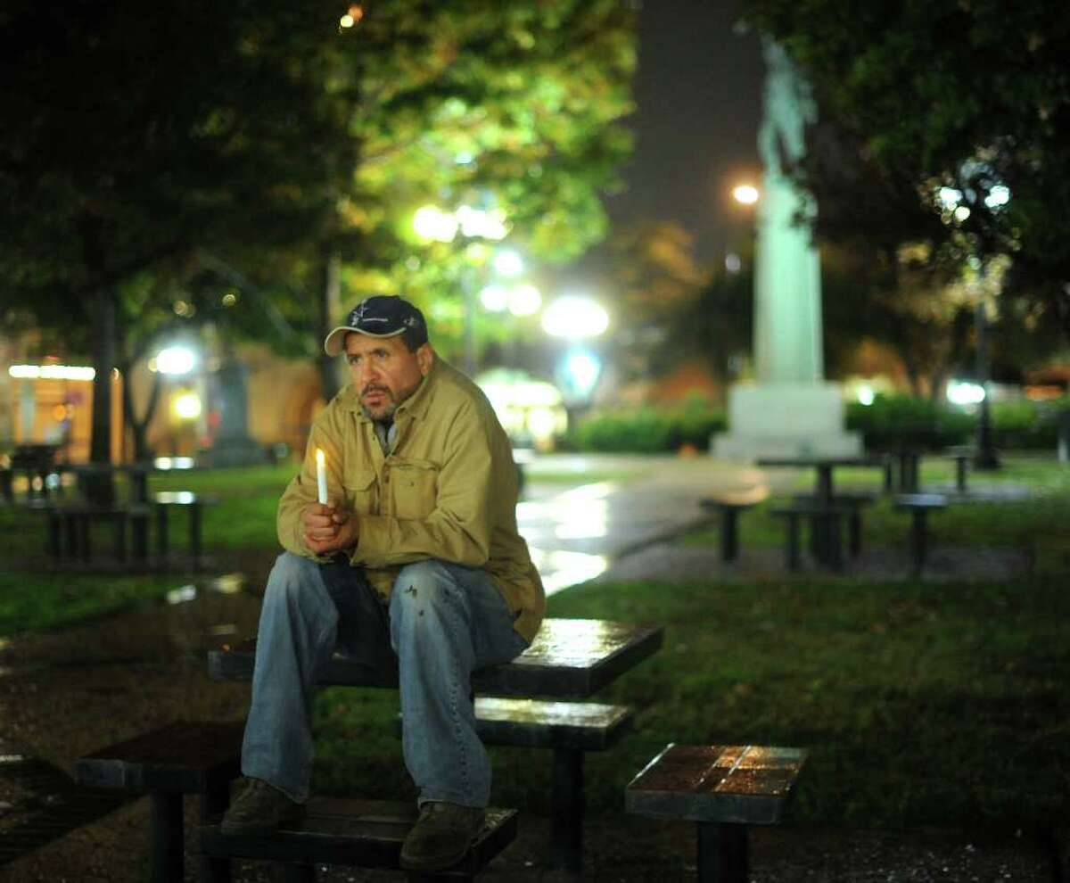 Robert Rivera, who has been homeless but who has been assisted by Haven for Hope, listens during the fifth annual Homeless Persons' Memorial Service at Milam Park on Wednesday, Dec. 21, 2011.