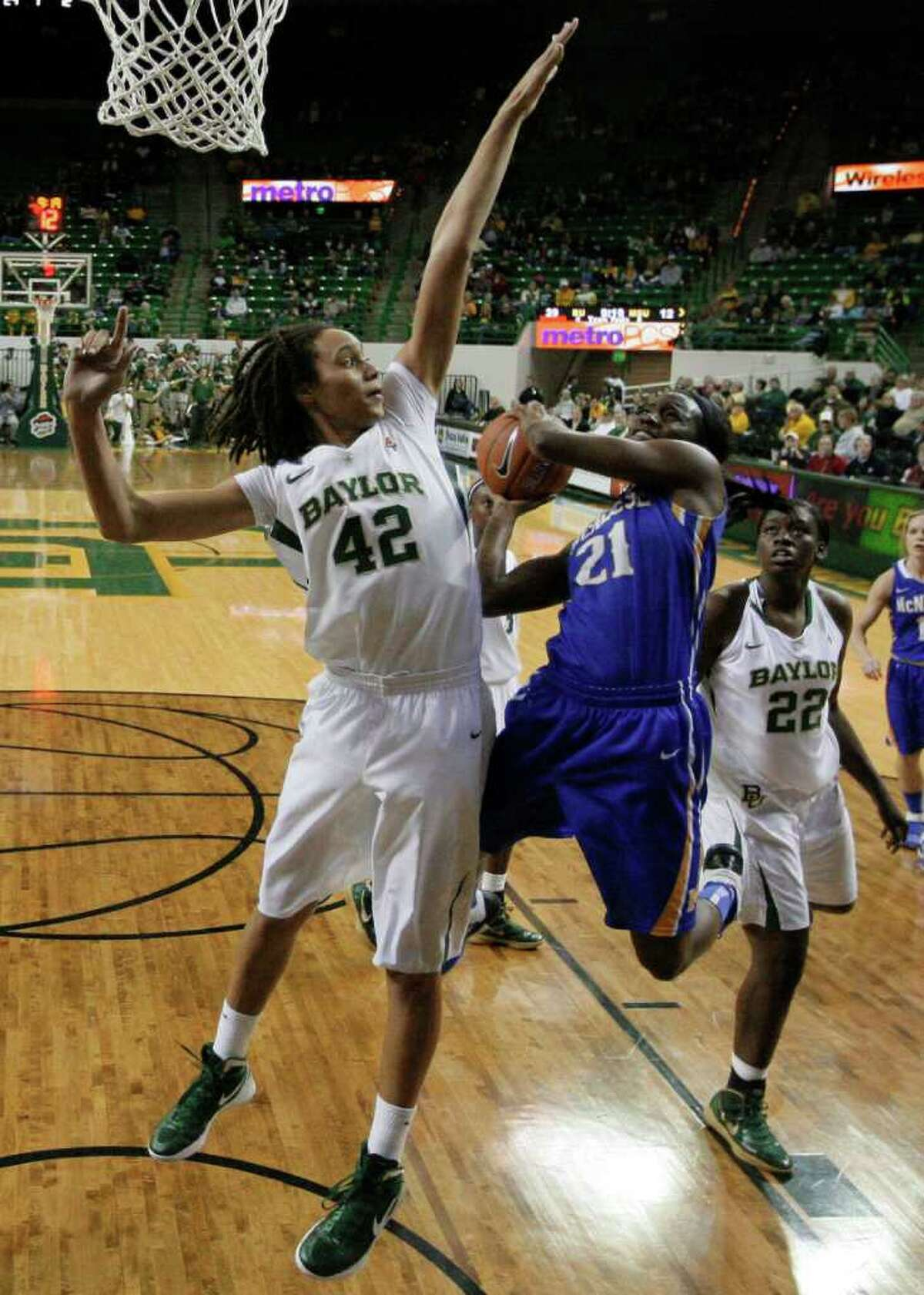 Baylor's Brittney Griner makes a shot attempt by McNeese State's Kendra Wells a lot tougher.