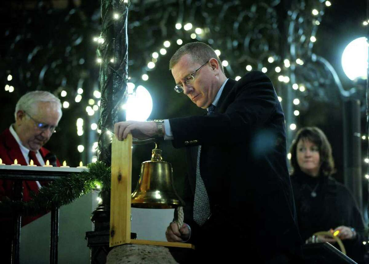 John Seiders, executive pastor of First Presbyterian Church, rings a bell once for each homeless person who died in San Antonio in 2011. The memorial service was held on Wednesday, Dec. 21, the longest night of the year.