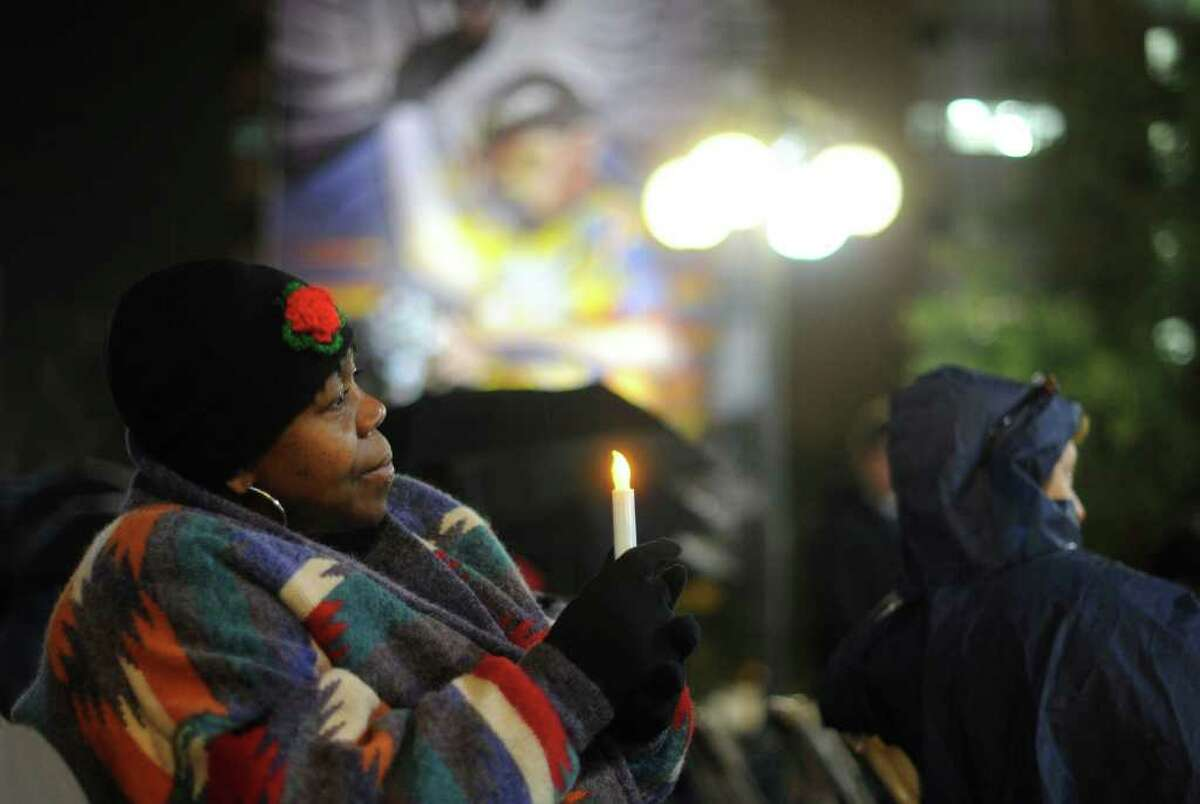 Barbara Hood, who lives at Haven for Hope, holds a candle during the Homeless Persons' Memorial Service at Milam Park on Wednesday, Dec. 21, 2011.