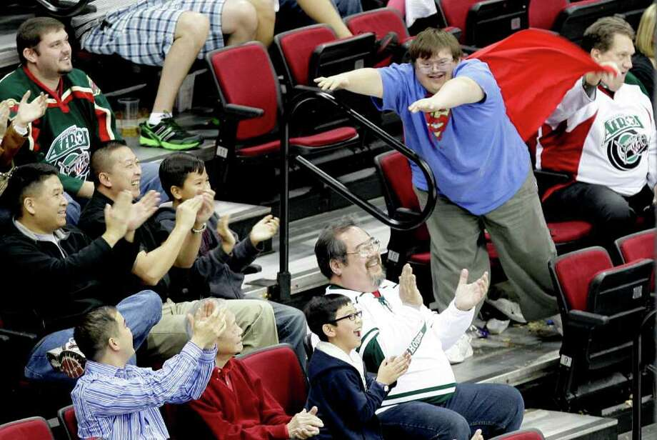12/21/11: A Houston Aeros fan does the superman to cheer on the Houston Aeros against the Texas Stars in the second period of a hockey game at Toyota Center in Houston, Texas. Photo: Thomas B. Shea, For The Chronicle / © 2011 Thomas B. Shea
