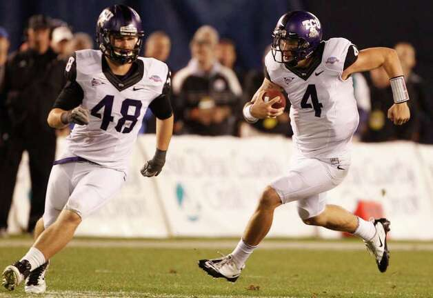 TCU quarterback Casey Pachall scrambles for a first down against Louisiana Tech as he follows fullback Luke Shivers during the first half of the Poinsettia Bowl NCAA college football game Wednesday, Dec. 21, 2011, in San Diego. Photo: AP