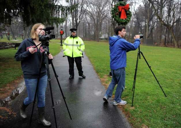 Students from Greens Farms Academy, Eliza Moley, 15, and Jack Kauffman, 18, film the Occupy Darien rally at Tilley Pond Park in Darien, Conn. Wednesday, December 21, 2011. Photo: Autumn Driscoll / Connecticut Post