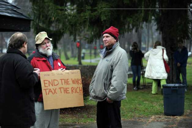 Protesters Richard Duffee, left, of Stamford, and John Konicki, of Vernon, talk politics during the Occupy Darien rally at Tilley Pond Park in Darien, Conn. Wednesday, December 21, 2011. Photo: Autumn Driscoll / Connecticut Post