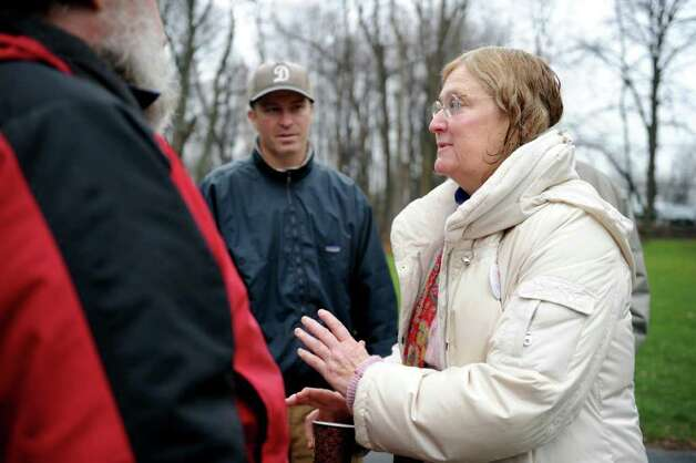 Occupy Darien organizer Margaret Rague, of Darien, talks to protesters during the rally at Tilley Pond Park in Darien, Conn. Wednesday, December 21, 2011. Photo: Autumn Driscoll / Connecticut Post