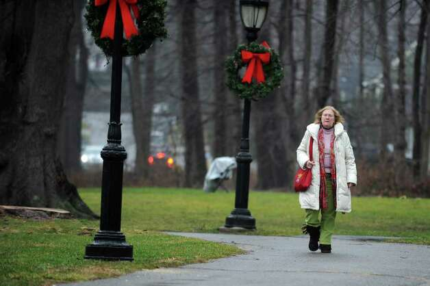 Occupy Darien organizer Margaret Rague walks through Tilley Pond Park in Darien, Conn. Wednesday, December 21, 2011. Photo: Autumn Driscoll / Connecticut Post