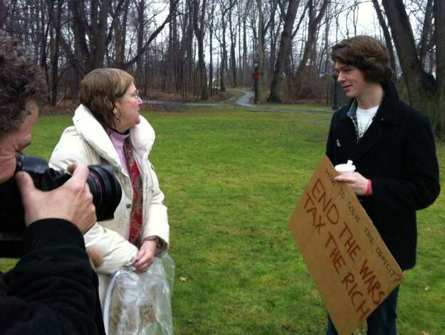 Occupy Darien organizer Margaret Rague of Darien greets Cole Stangler of New Canaan in Tilley Pond Park on Wednesday, Dec. 21, 2011. Photo: John Nickerson
