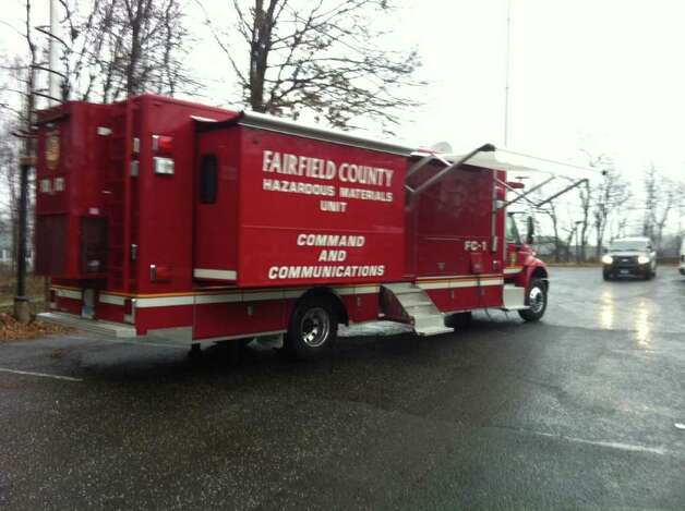 A Fairfield County Hazardous Materials truck is on scene at Tilley Pond Park in Darien, Conn. on Wednesday, Dec. 21, 2011 as a precaution for the Occupy Darien protests. Photo: John Nickerson