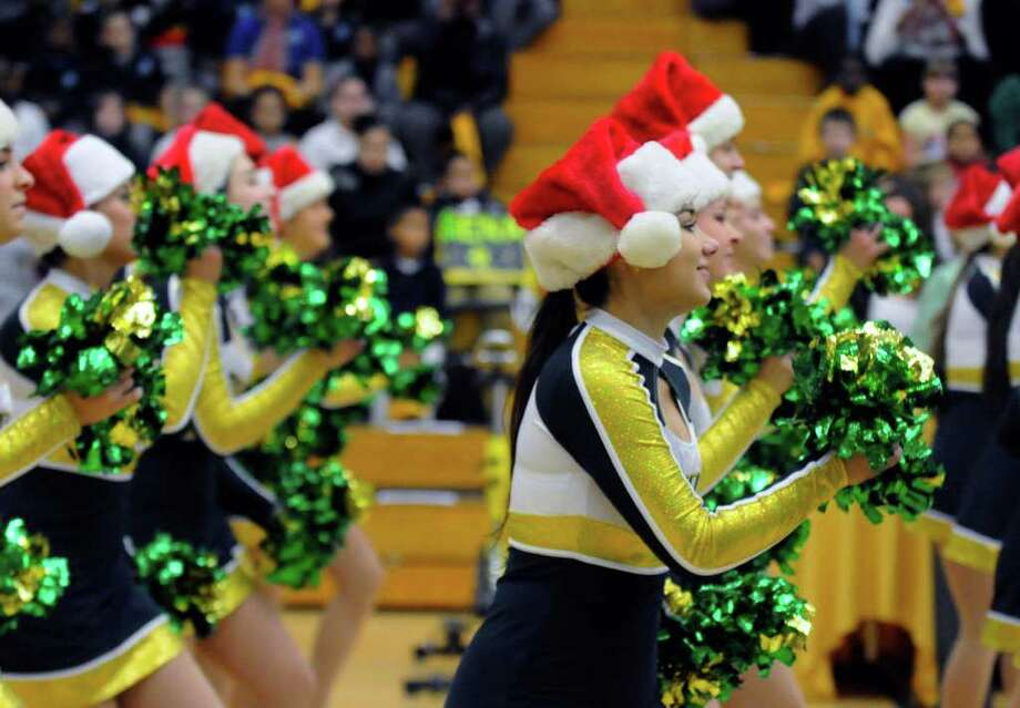 The Siena College dance team cheers on the Lady Saints during their game againsy UMass in Loudonville,NY Wednesday, Dec.21, 2011.( Michael P. Farrell/Times Union) Photo: Michael P. Farrell