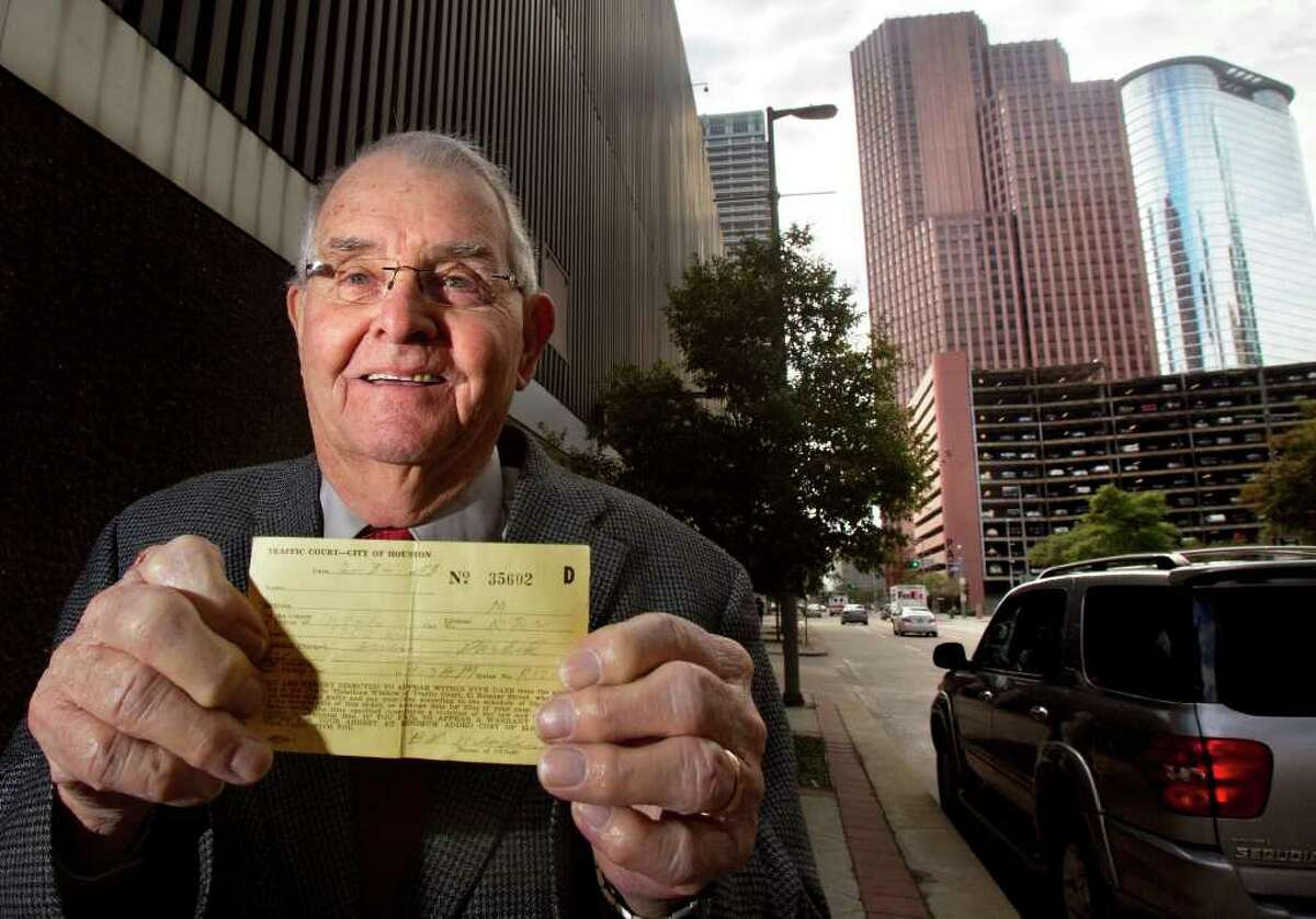 CODY DUTY : CHRONICLE PAYING UP: Dale Crawford on Wednesday stands in the 1200 block of Milam, where this $1 parking ticket was issued 58 years ago.