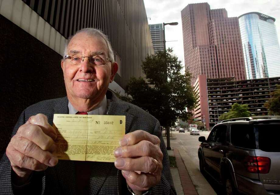 "CODY DUTY : CHRONICLE PAYING UP: Dale Crawford on Wednesday stands in the 1200 block of Milam, where this $1 parking ticket was issued 58 years ago. ""It is a debt, and I want to pay what I owe."" Photo: Cody Duty / © 2011 Houston Chronicle"
