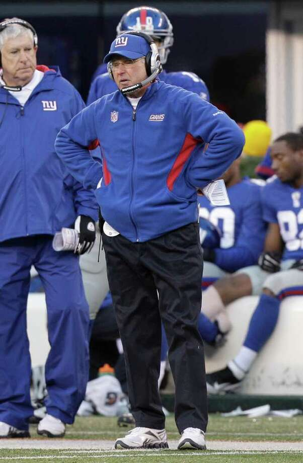 New York Giants head coach Tom Coughlin reacts during the fourth quarter of an NFL football game against the Washington Redskins, Sunday, Dec. 18, 2011, in East Rutherford, N.J. The Redskins defeated the Giants 23-10. (AP Photo/Kathy Willens) Photo: Kathy Willens