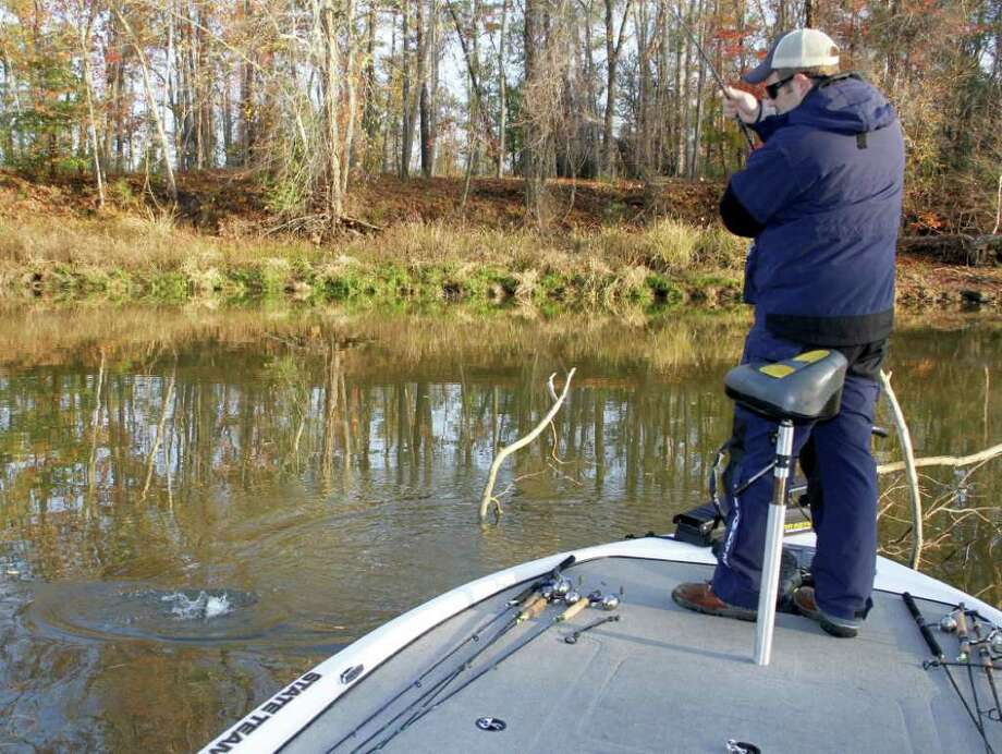 UP-AND-DOWN ACTION: Lake Livingston fishing guide Simon Cosper employs a long rod allowing precise vertical fishing in thick brush along steep-sided creeks to consistently take crappie during cold-weather months. Photo: Shannon Tompkins