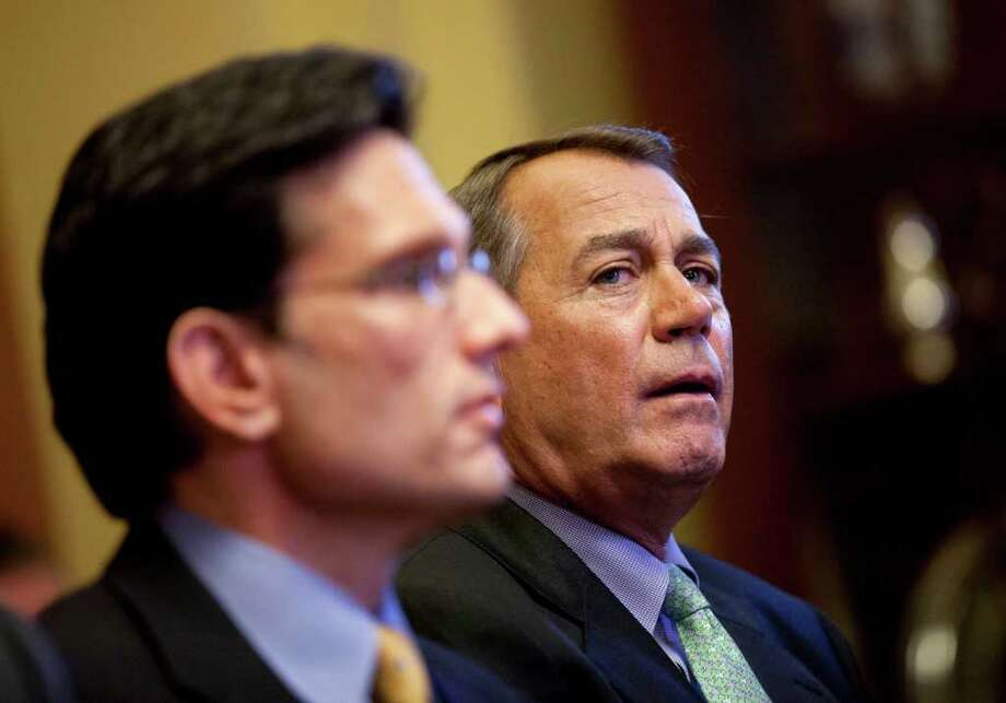 Speaker of the House Rep. John Boehner, R-Ohio, right, and House Majority Leader Rep. Eric Cantor, R-Va., hold a meeting with the conference committee on the payroll tax cut on Wednesday, Dec. 21, 2011 in Washington.  (AP Photo/Evan Vucci) Photo: Evan Vucci