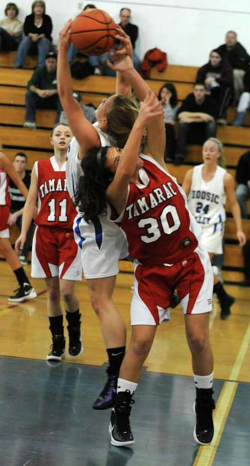 Hoosic Valley's Alicia Lewis battles for the ball with Tamarac's Brianna Matazinsky during a basketball game on Wednesday, Dec. 21, 2011 in Schaghticoke, N.Y. (Lori Van Buren / Times Union) Photo: Lori Van Buren