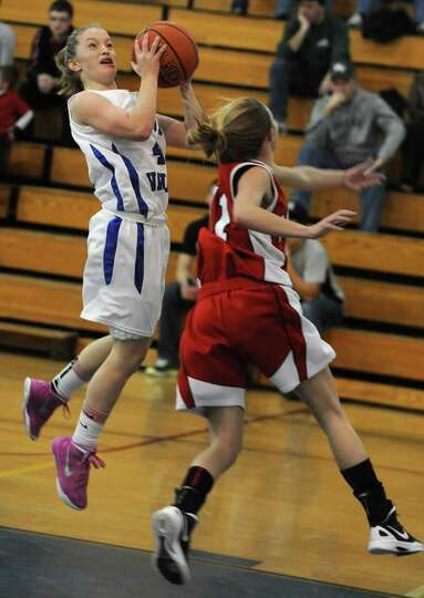 Hoosic Valley's Cassidy Chapko drives to the basket guarded by Tamarac's Jenna Erickson during a bas