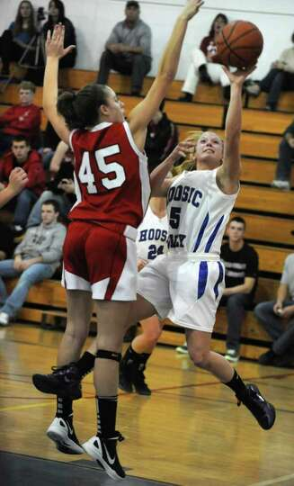 Hoosic Valley's Alicia Lewis goes up for a shot against Tamarac's Krystyn Knockwood, #45, during a b