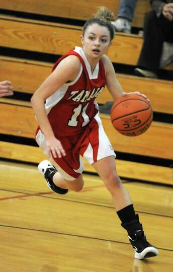 Tamarac's Jenna Erikson drives to the basket during a basketball game against Hoosic Valley on Wedne