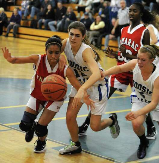 From left, Tamarac's Taulie Frierson and Hoosic Valley's Morgan Anderson and Alicia Lewis scramble t