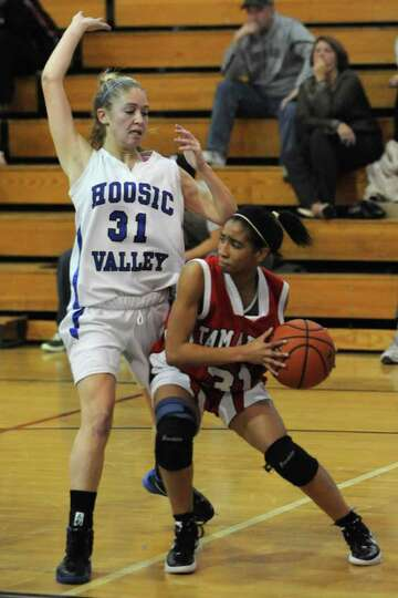 From left, Hoosic Valley's Kim Kocienski received a foul for pushing Tamarac's Taulie Frierson durin