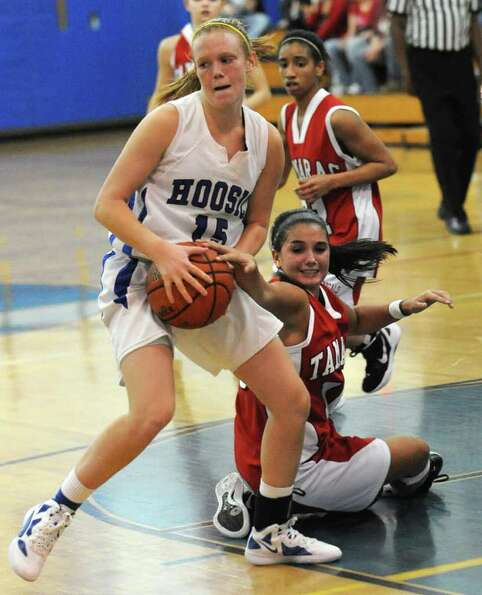 Hoosic Valley's Whitney Kugler wins a loose ball struggle with Tamarac's Brandi Warner during a bask