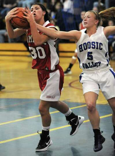 Tamarac's Brianna Matazinsky, #30, battles with Hoosic Valley's Alicia Lewis for a rebound during a