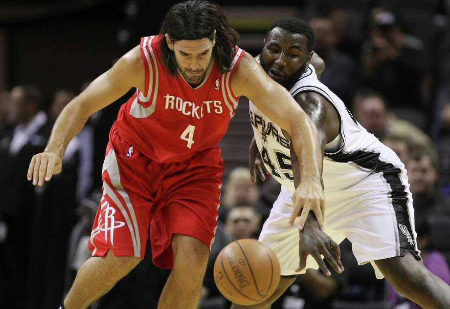 San Antonio Spurs DeJuan Blair steals the ball from Houston Rockets Luis Scola during the first half an NBA pre-season game at the AT&T Center in San Antonio, Wednesday, Dec. 21, 2011. JERRY LARA/glara@express-news.net Photo: JERRY LARA, Express-News / SAN ANTONIO EXPRESS-NEWS