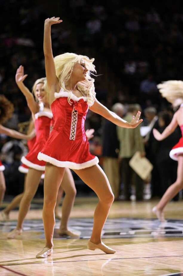 San Antonio Spurs dancers dress for the season as they perform during a preseason game against the Houston Rockets at the AT&T Center in San Antonio, Wednesday, Dec. 21, 2011. The Spurs won 97-95. JERRY LARA/glara@express-news.net Photo: JERRY LARA, Express-News / SAN ANTONIO EXPRESS-NEWS