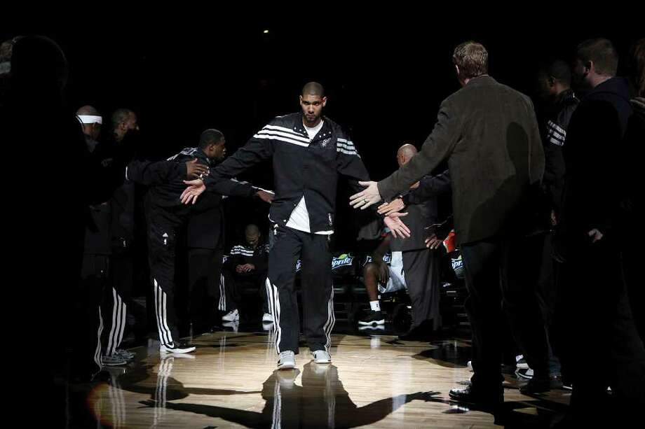 San Antonio Spurs Tim Duncan is introduced at the start of their preseason game against the Houston Rockets at the AT&T Center in San Antonio, Wednesday, Dec. 21, 2011. JERRY LARA/glara@express-news.net Photo: JERRY LARA, Express-News / SAN ANTONIO EXPRESS-NEWS