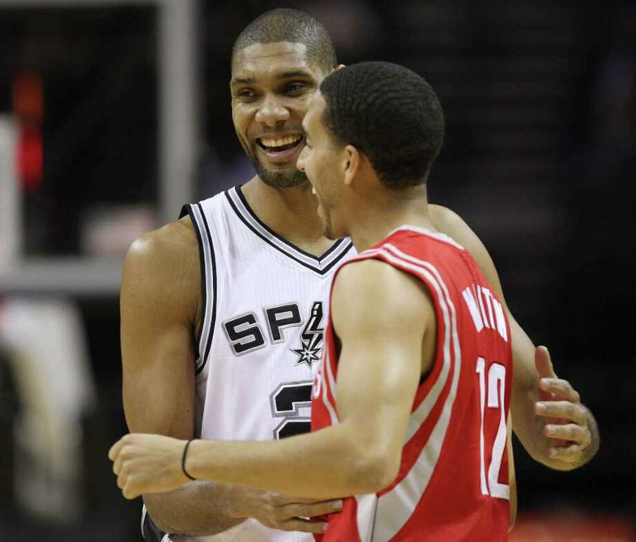 San Antonio Spurs Tim Duncan greets Houston Rockets Kevin Martin before a preseason game at the AT&T Center in San Antonio, Wednesday, Dec. 21, 2011. JERRY LARA/glara@express-news.net Photo: JERRY LARA, Express-News / SAN ANTONIO EXPRESS-NEWS