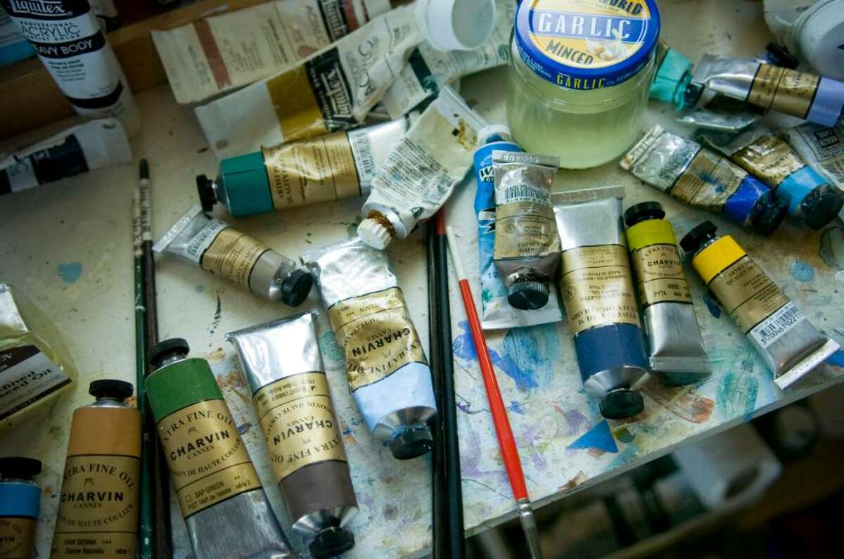 Oil paint and brushes in Pamela Riley-Abear's home studio in the Shippan section of Stamford on Monday, Oct. 18, 2009.