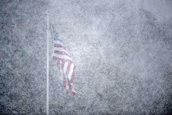 Snow falls over the Staples vs. Darien football game Saturday, Oct. 29, 2011 in Westport, Conn.