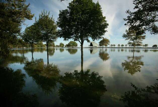 Seaside Park in Bridgeport remains flooded on Monday, August 29, 2011, with sea water from the storm surge of Hurricane Irene. Photo: Brian A. Pounds / Connecticut Post