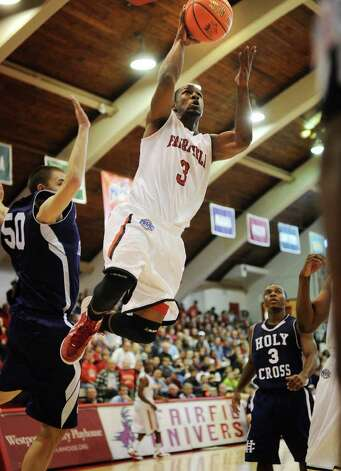 Fairfield's Derek Needham drives to the hoop during the Stags' victory over Holy Cross at Alumni Hall in Fairfield on Sunday, November 20, 2011. Photo: Brian A. Pounds / Connecticut Post