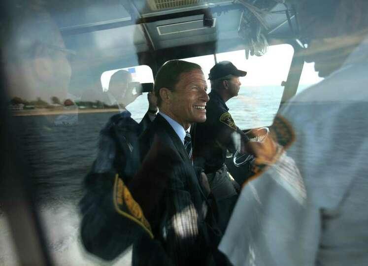 Senator Richard Blumenthal tours coastal damage from Hurricane Irene on a Bridgeport police boat on